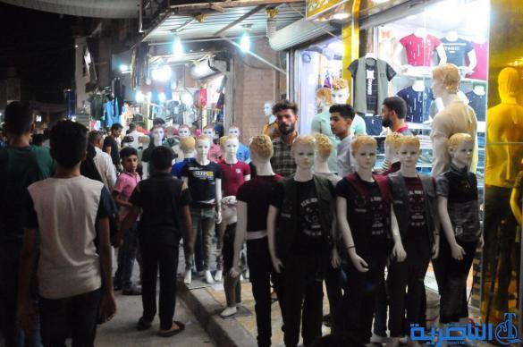 بالصور : اسواق الناصرية لا تنام استعدادا لعيد الفطر المبارك
