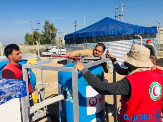 جمعية الهلال الاحمر تنصب محطة لتصفية المياه في البطحاء -تقرير مصور -