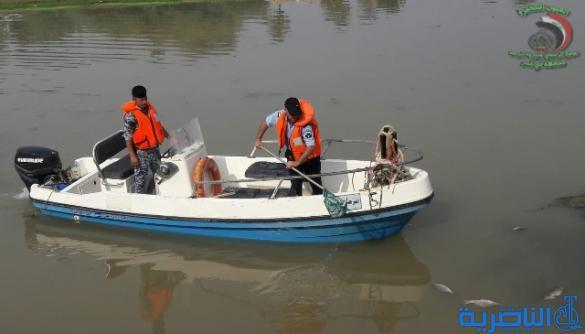 بالصور: شرطة ذي قار ترصد اسماكا نافقة في نهر الغراف شمالي المحافظة