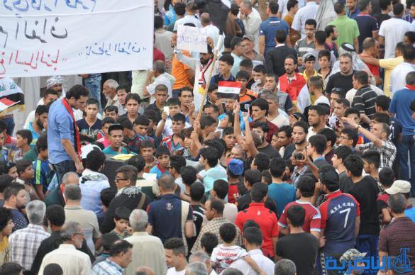 بالصور : المئات يتظاهرون في الناصرية للمطالبة  بالمزيد من الاصلاحات