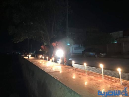 بالصور:ابناء قلعة سكر يوقدون الشموع استذكارا لضحايا حادثة الموصل