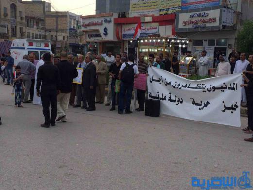 بالصور : متظاهرو الناصرية يطالبون بالعدالة الاجتماعية ومحاسبة المفسدين