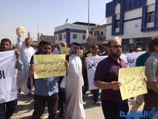 بعد ان قفزت اسعارة الى الضعف ، الطحين المفقود يدفع العشرات للتظاهر في الناصرية - تقرير مصور -