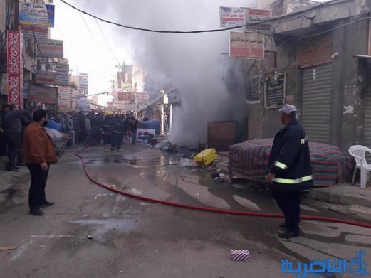 اصابة رجل اطفاء واحتراق عدد من المحال التجارية وسط الناصرية