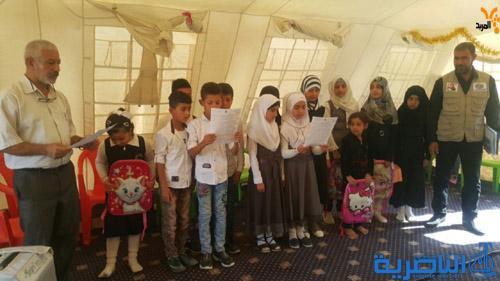 توزيع مستلزمات مدرسية على 150 طفل نازح في ذي قار