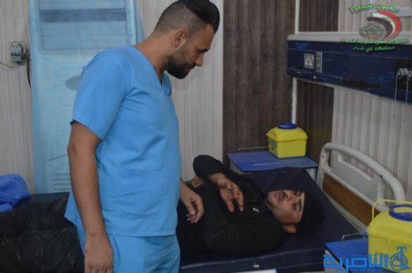شرطة ذي قار تعلن اصابة 36 منتسبا من عناصرها في تظاهرة الناصرية - تقرير مصور -