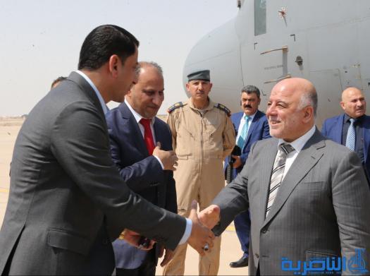 بالصور:وصول رئيس الوزراء حيدر العبادي الى مطار الناصرية الدولي