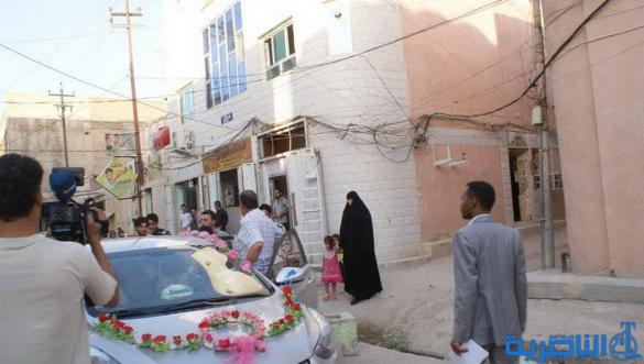 الناصرية تشهد اول زواج لعريسين نازحين من الموصل - تقرير مصور -