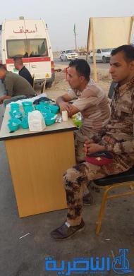بالصور:موكب حسيني لقاعدة الامام علي الجوية خدمة لزوار الاربعين